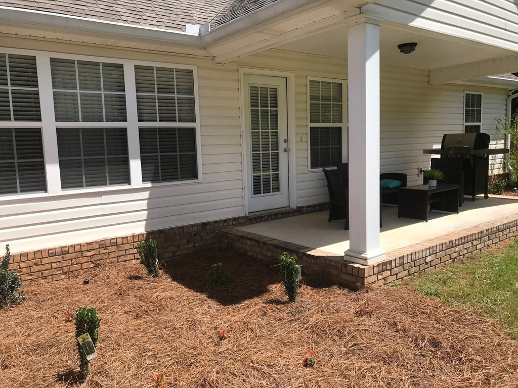 Covered porch with flower beds