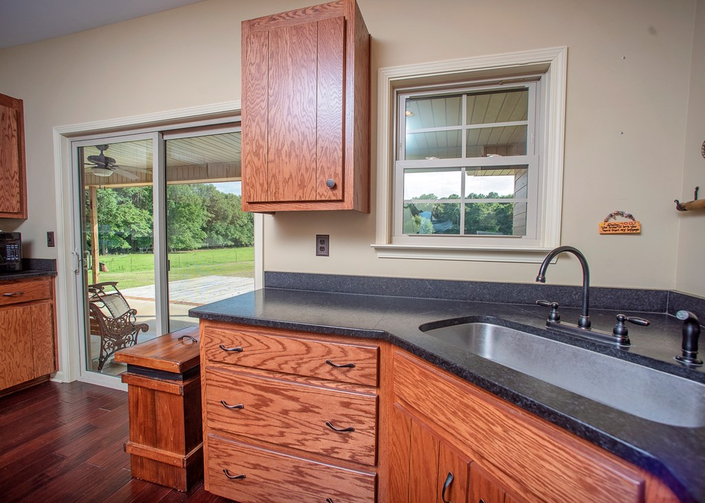 Farm Sink & Leathered Granite Countertops