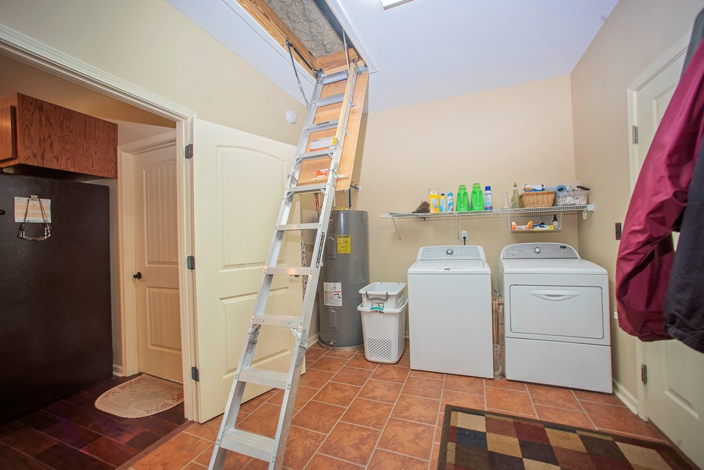 Laundry Room has Pull Down Stairs.