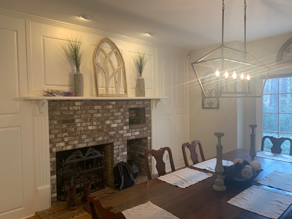 Gas Log Fireplace in Dining Room